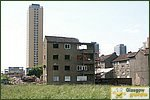 Glasgow City Guide Photographs: BarmullochTenements Being Demolished 02.JPG31 December 2003 12:56