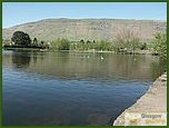 Glasgow City Guide Photographs: Lennoxtown  Whitefield Pond 11.JPG  11 July 2006 21:13